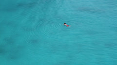 Survivor swimming in turquoise seawaters Stock Footage