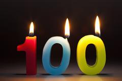 Three Candles In The Shape Of The Number 100 - stock photo