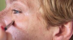 Stock Video Footage of Esthetician - Closeup woman having applied makeup by makeup artist