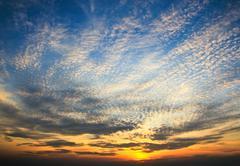 Dramatic sunset sky with clouds Stock Photos