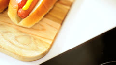 Close Up Hot Dogs Dressed Mild Yellow Mustard Tomato Ketchup Stock Footage