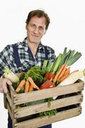 A man delivering organic groceries - stock photo