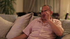 middle age man watching television and zapping channel  - stock footage