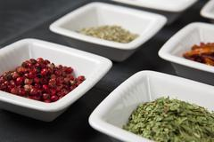 Detail of herbs and spices in small bowls Stock Photos