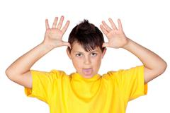 Funny child with yellow t-shirt mocking Stock Photos