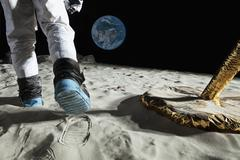 An astronaut walking on the moon, rear view, low section Stock Photos