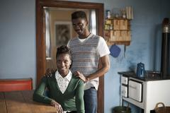 Portrait of a young couple in a domestic kitchen - stock photo