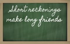 expression -  short reckonings make long friends - written on a school blackb - stock photo