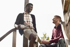 Two friends sitting on a staircase Stock Photos