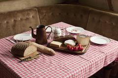 A simple rustic meal laid out on a set table Stock Photos