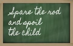 Stock Illustration of expression -  spare the rod and spoil the child - written on a school blackbo