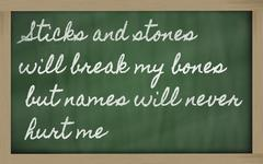 expression -  sticks and stones will break my bones but names will never hurt - stock photo