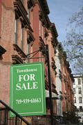 FOR SALE sign in front of a townhouse, Brooklyn, New York, USA Stock Photos