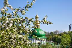 kiev pechersk lavra monastery and tree in blossom - stock photo