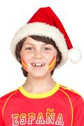 smiling child fan of the spanish team in christmas - stock photo