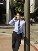 A businessman using a mobile Stock Photos