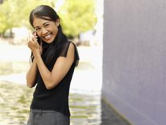 A businesswoman using a mobile phone Stock Photos