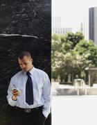 A businessman using a smart phone - stock photo