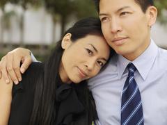 An affectionate businessman and businesswoman Stock Photos
