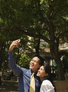 An romantic, business couple taking a photograph of themselves - stock photo