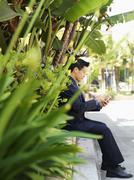 A businessman using a smart phone Stock Photos