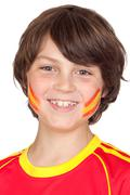 smiling child fan of the spanish team - stock photo