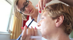 Esthetician - Closeup woman having applied makeup by makeup artist Stock Footage