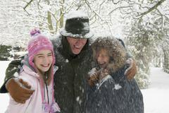 A girl with her grandparents in the snow Stock Photos
