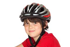 Funny child bike helmet Stock Photos