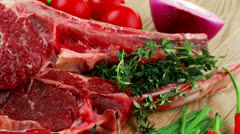 Fresh spare ribs : raw lamb with thyme  red chili pepper Stock Footage