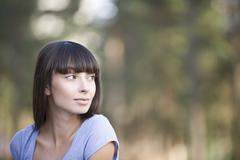 Stock Photo of A young woman looking over her shoulder, portrait