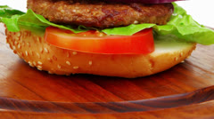 Double roasted hamburger on wooden plate Stock Footage