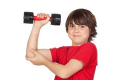 funny child playing sports with weights - stock photo