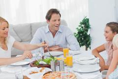 Stock Photo of Family around the dinner table