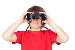 Little boy looking through binoculars Stock Photos