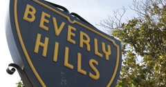 Ultra HD 4K Beverly Hills Sign symbol luxury Street Sign, Los Angeles, Blue Sky - stock footage