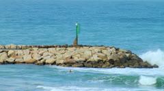 Wave Breaker on beach tel aviv Stock Footage
