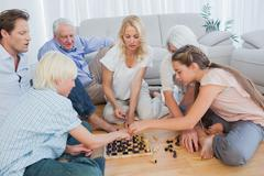 Stock Photo of Extended family playing chess