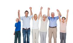 Smiling family raising their arms Stock Photos