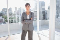 Stock Photo of Confident businesswoman in bright office