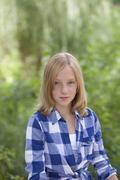 Girl in checked shirt Stock Photos