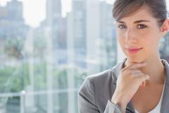 Stock Photo of Thoughtful businesswoman smiling at camera