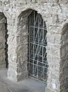 Scaffolding in stone archway Stock Photos