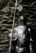 Suit of armor with an axe Stock Photos
