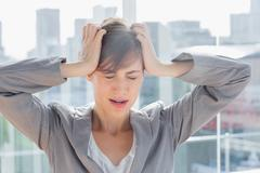 Stock Photo of Frustrated businesswoman with hands on head