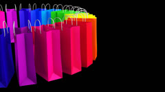 Isolated multicolored sale bags on black - stock footage