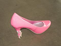 A pink stiletto with bit marks - stock photo