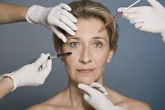 Woman thinking about plastic surgery Stock Photos