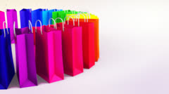 Isolated multicolored sale bags on white Stock Footage