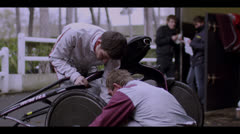 MEN FIXING WHEEL Stock Footage